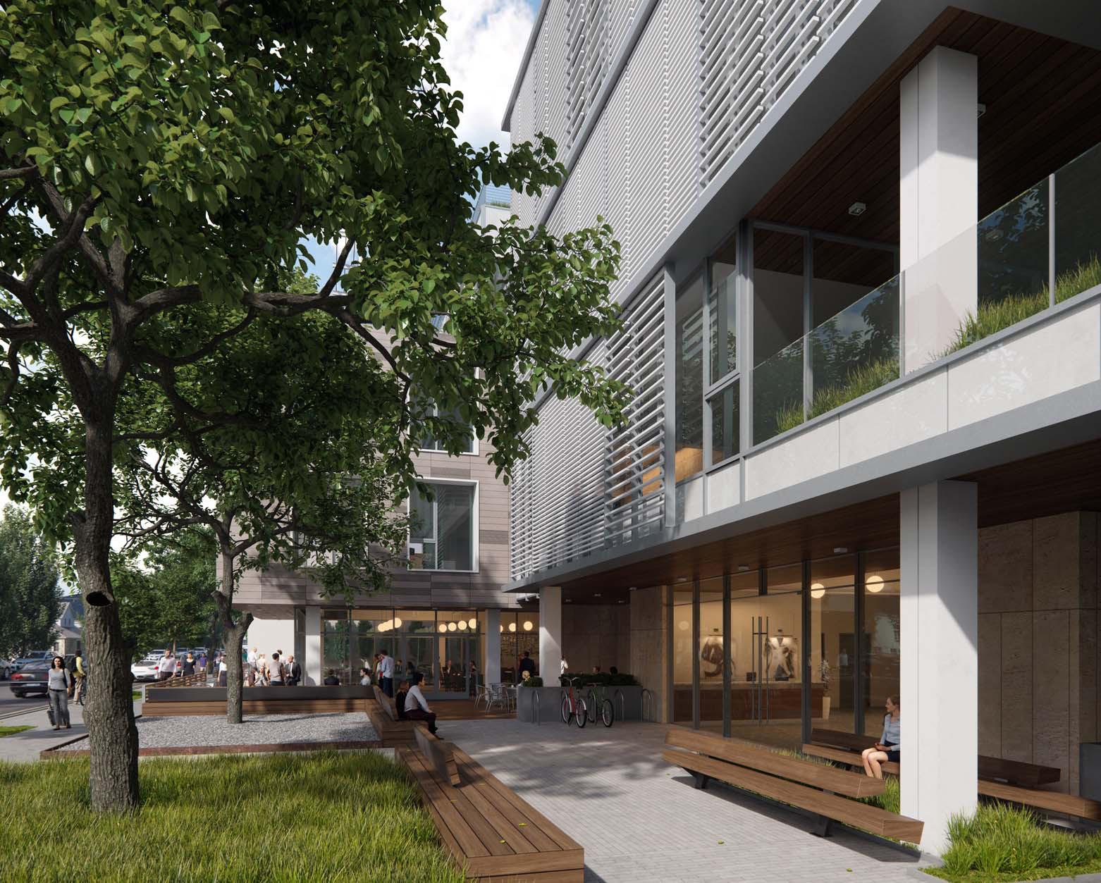 Magnolia trees shade entrance of 950 Villa LEED office building design brick-inc