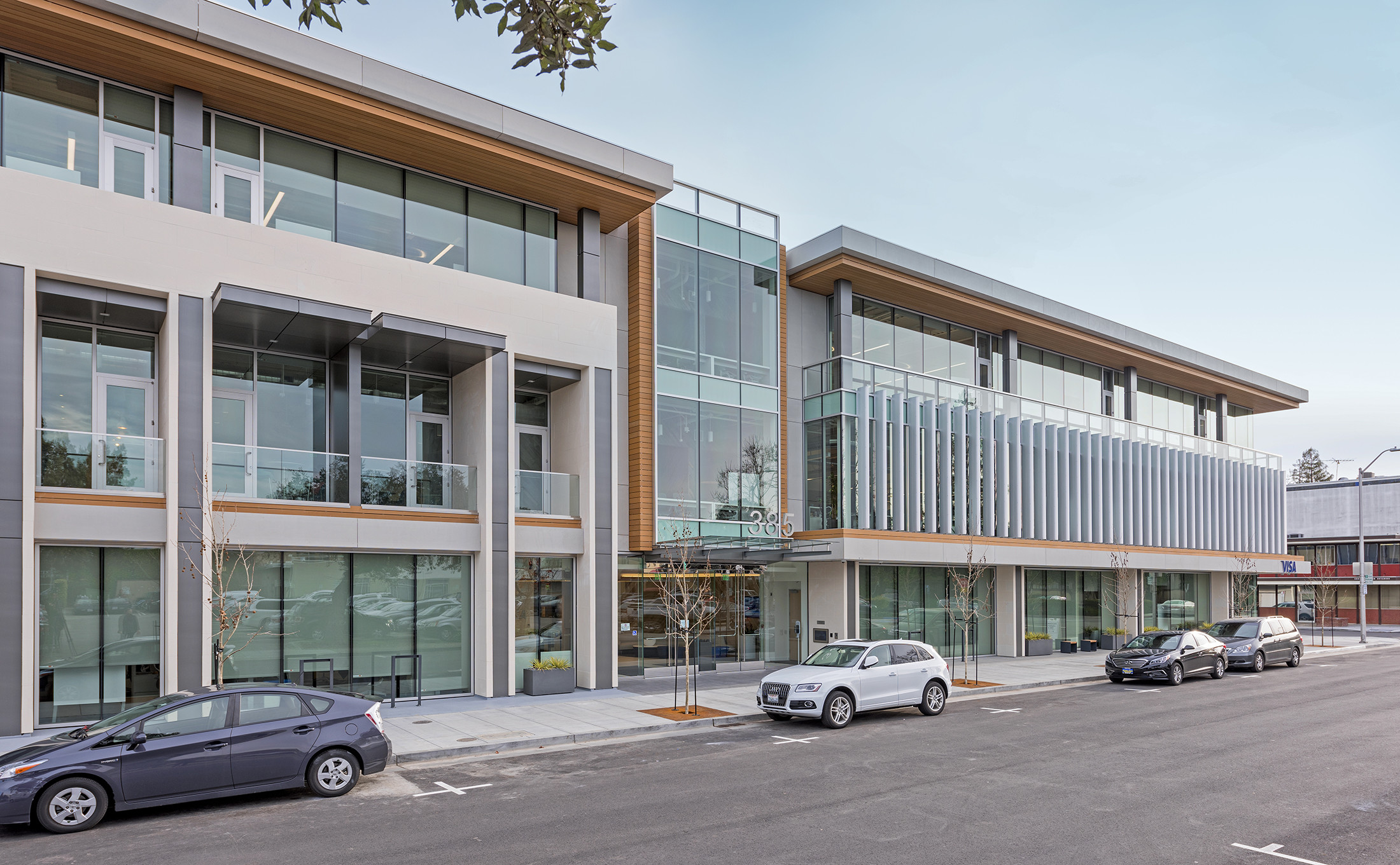 Night Exterior entrance and windows of office building Visa Palo Alto brick-inc architects