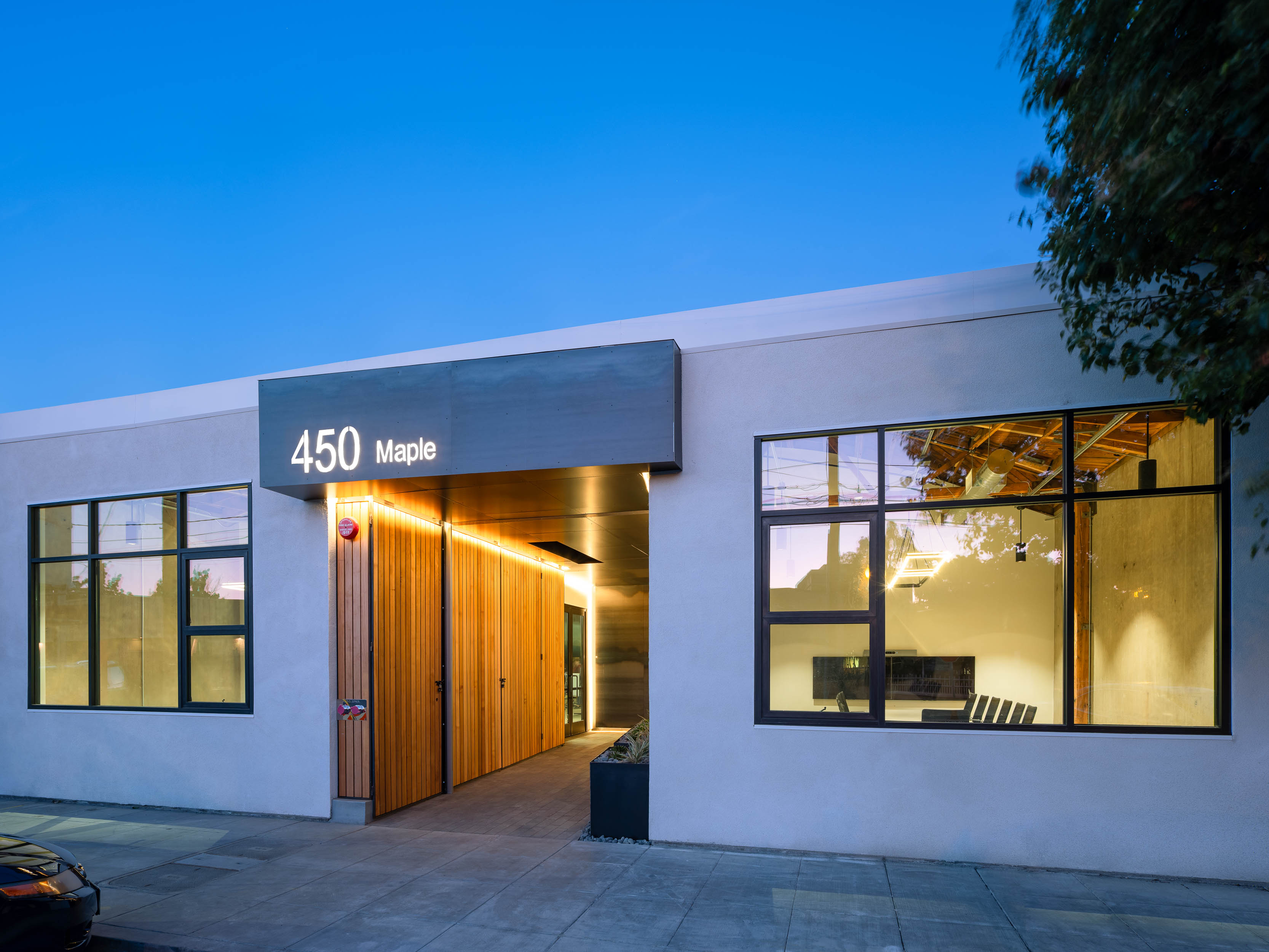 Night Exterior entrance and windows of office building Visa Palo Alto brick-inc architects